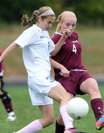 Hamilton: Hamilton-Wenham sophomore Emma Beane (3) collides with Newburyport sophomore Abbie Bresnahan (4) as they battle for a 50/50 ball on Wednesday afternoon. David Le/Salem News