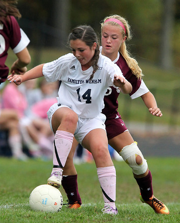Hamilton: Hamilton-Wenham sophomore Molly Eagar (14) controls the ball while being pressured by Newburyport sophomore Isabella Palma (16) during the first half of play on Wednesday afternoon. David Le/Salem News