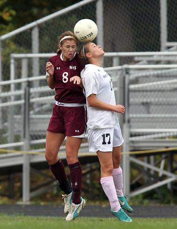 Hamilton: Hamilton-Wenham junior Jillian Kefalas (17) and Newburyport senior Julia Kipp (8) battle for a header on Wednesday afternoon. David Le/Salem News