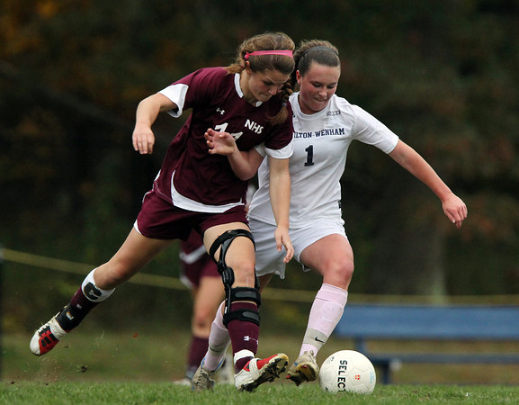 Hamilton: Hamilton-Wenham senior captain Caroline Gribbell (1) battles with Newburyport senior captain Carly Brand (11) for possession of the ball on Wednesday afternoon.David Le/Salem News