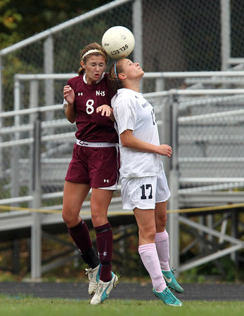 Hamilton: Hamilton-Wenham junior Jillian Kefalas (17) and Newburyport senior Julia Kipp (8) battle for a header on Wednesday afternoon. David Le/Salem News