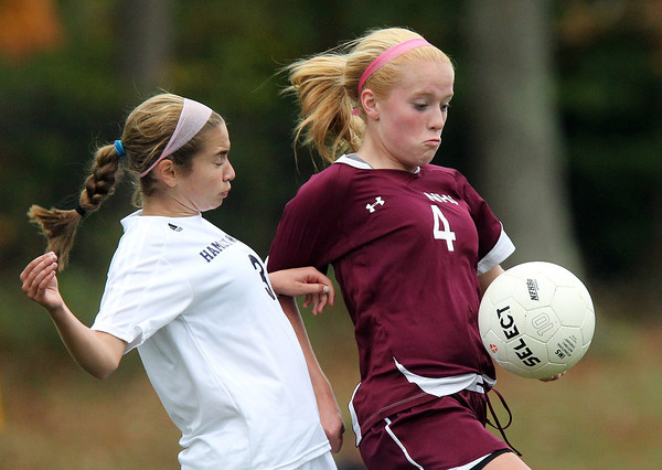 Hamilton: Newburyport sophomore striker Abbie Bresnahan (4) controls the ball with her body while being pressured by Hamilton-Wenham sophomore Emma Beane (3) on Wednesday afternoon. David Le/Newburyport Daily News