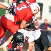 Tewksbury: Marblehead senior captain Jeremy Gillis (23) upends Tewksbury running back James Sullivan (3) during the first half of the D2 Northeast Championship game at Doucette Field in Tewksbury on Saturday afternoon. The Magicians fell to the Redmen 34-21. David Le/Salem News