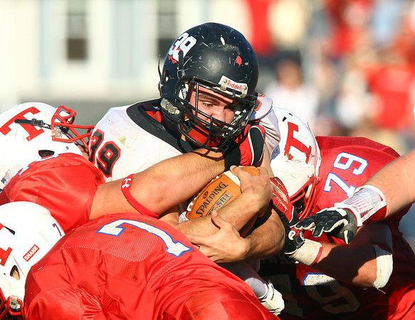 Tewksbury: Marblehead senior Ben Anderson (39) tries to power through the Tewksbury defense during the D2 Northeast Championship game at Doucette Field in Tewksbury on Saturday afternoon. The Magicians fell to the Redmen 34-21. David Le/Salem News