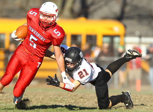 Tewksbury: Marblehead senior Trey Blackmer (21) dives at the legs of Tewksbury senior Kevin Dick (5) during the first half of play in the D2 Northeast Championship game at Doucette Field in Tewksbury on Saturday afternoon. The Magicians fell to the Redmen 34-21. David Le/Salem News