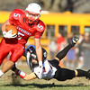 Tewksbury: Marblehead senior cornerback Trey Blackmer (21) makes a diving attempt to bring down Tewksbury senior wide receiver Kevin Dick (5) during the first half of play of the D2 Northeast Championship game at Doucette Field in Tewksbury on Saturday afternoon. The Magicians fell to the Redmen 34-21. David Le/Salem News