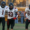 Tewksbury: Marblehead junior Romello Matthews (1) puts his arm around senior captain Jeremy Gillis (23), while senior Trevor Gelineau (64) stands with his hands on his hips after the Magicians fell to Tewksbury 34-21 in the D2 Northeast Championship game at Doucette Field in Tewksbury on Saturday afternoon. David Le/Salem News