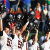 Tewksbury: The Marblehead football team raises their helmets in the air prior to the start of the D2 Northeast Championship game at Doucette Field in Tewksbury on Saturday afternoon. The Magicians fell to the Redmen 34-21. David Le/Salem News