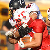 Tewksbury: Marblehead senior captain Jeremy Gillis (23) drags down Tewksbury junior running back James Sullivan (3) during the D2 Northeast Championship game at Doucette Field in Tewksbury on Saturday afternoon. The Magicians fell to the Redmen 34-21. David Le/Salem News