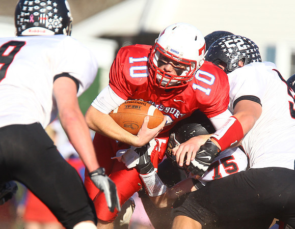 Tewksbury: Marblehead junior Tommy Gabel (75) and senior captain Liam Gillis (52) take down Tewksbury quarterback Johnny Aylward (10) during the first half of the D2 Northeast Championship game at Doucette Field in Tewksbury on Saturday afternoon. The Magicians fell to the Redmen 34-21. David Le/Salem News