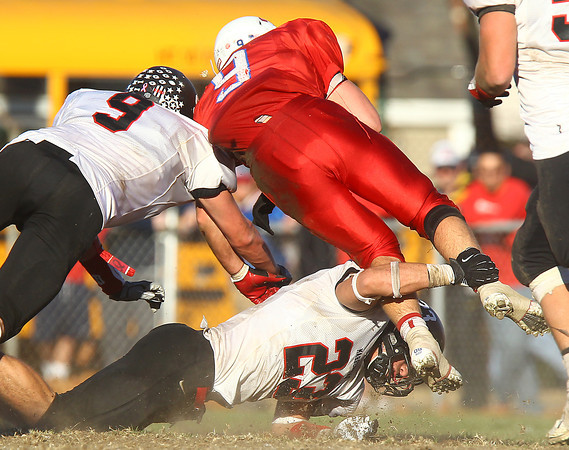 Tewksbury: Marblehead senior captain Jeremy Gillis (23) and junior Will Millett (9) upend Tewksbury junior Tom Casey (9) during the D2 Northeast Championship game at Doucette Field in Tewksbury on Saturday afternoon. The Magicians fell to the Redmen 34-21. David Le/Salem News