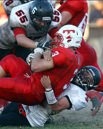 Tewksbury: Marblehead senior Tom Koopman (55) and junior Spencer Craig (3), drag down Tewksbury junior running back James Sullivan (3) for a loss of yards during the D2 Northeast Championship game at Doucette Field in Tewksbury on Saturday afternoon. The Magicians fell to the Redmen 34-21. David Le/Salem News