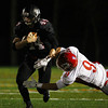 Marblehead: Marblehead junior running back Brooks Tyrrell (44) stiff arms aside Masco junior Gavin Monagle (9) on Friday evening. David Le/Salem News