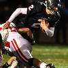 Marblehead: Marblehead senior quarterback Matt Millett (2) plows ahead for a few more yards against Masco on Friday evening. David Le/Salem News