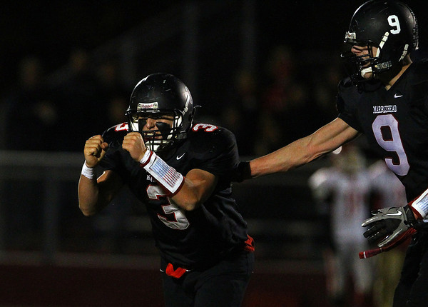 Marblehead: Marblehead junior Spencer Craig (3) pumps both his fists after he sacked Masco quarterback Troy Bunker for a huge loss of yardage on 4th down to force a Chieftans turnover on Friday evening in the D3 Northeast Semi-final. David Le/Salem News