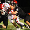Marblehead: Masco senior running back Mike MacKay (5) can't escape the firm grasp from Marblehead junior Will Millett (9). David Le/Salem News