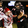Marblehead: Marblehead junior running back Brooks Tyrrell (44) turns the corner and evades diving Masco senior Logan Thompson (31) and breaks upfield for a big gain. David Le/Salem News