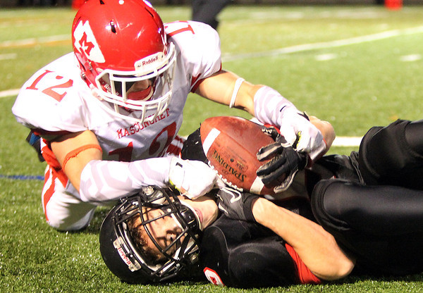 Marblehead: Marblehead senior Dylan Cressy (5) hauls in an interception intended for Masco junior Corey Tines (12) during the first quarter of play on Friday evening. David Le/Salem News
