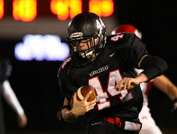 Marblehead: Marblehead junior running back Brooks Tyrrell (44) finds an open lane and takes the handoff from senior quarterback Matt Millett 53-yards to the end zone to give the Magicians a 7-0 lead over Masco in the D3 Northeast Semi-final on Friday evening. David Le/Salem News