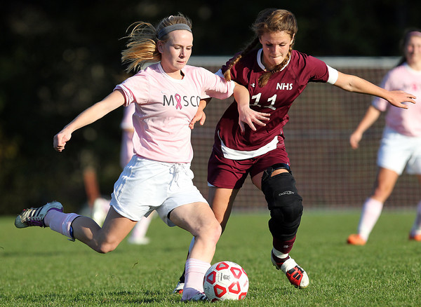 Boxford: Masco senior captain Kaleigh White (3) boots the ball upfield while being pressured by Newburyport senior captain Carly Brand (11) on Monday afternoon. David Le/Salem News