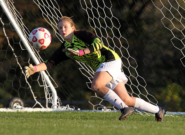 Boxford: Masco freshman goalie Katy Pelletier keeps her eyes on the ball while making a diving save against Newburyport on Monday afternoon. David Le/Salem News
