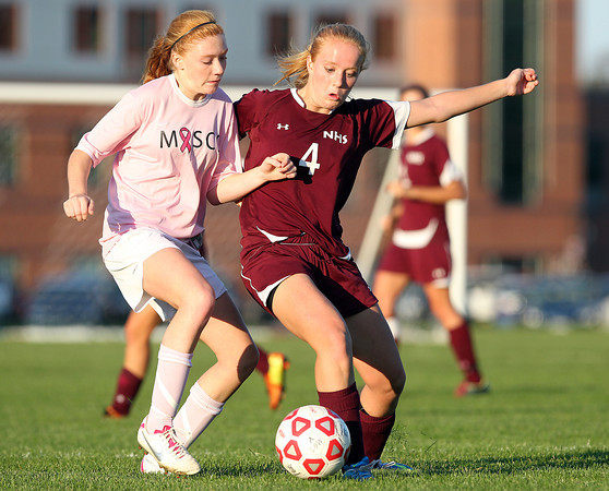Boxford: Newburyport sophomore Abbie Bresnahan (4) steps in to steal the ball from Masco sophomore Abby Reblin, left, during the second half of play on Monday afternoon. David Le/Newburyport Daily News