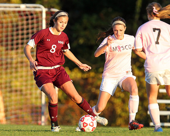 Boxford: Newburyport senior Julia Kipp (8) controls the ball while being pressured by Masco senior Sammi Sheehan (16) and Courtney Bouchard (7) on Monday afternoon. The Clippers and Chieftans battled to a 0-0 draw. David Le/Newburyport Daily News
