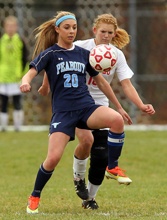 Boxford: Peabody senior captain Madison Doherty tries to control the ball while being pressured by Masco senior captain Sarah Katz (10) during the second half of play on Sunday afternoon. David Le/Salem News