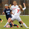 Boxford: Peabody senior captain Madison Doherty (20) tries to shake free from Masco senior Courtney Bouchard (7) on Sunday afternoon. David Le/Salem News