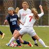Boxford: Peabody senior captain Madison Doherty (20) tries to shake free from Masco senior Courtney Bouchard (7) on Sunday afternoon. David Le/Salem News