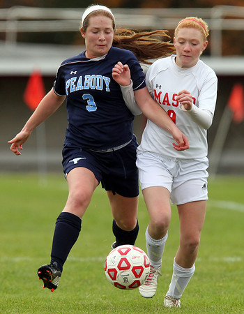 Boxford: Peabody defender Sarah Godschall (3) locks up with Masco sophomore forward Abby Reblin (9) on Sunday afternoon. David Le/Salem News