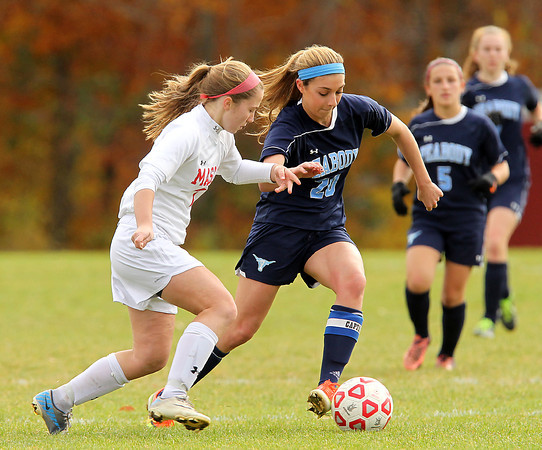 Boxford: Peabody senior captain Madison Doherty (20) tries to make a move past Masconomet senior midfielder Courtney Bouchard (7) during the second half of play on Sunday afternoon. David Le/Salem News
