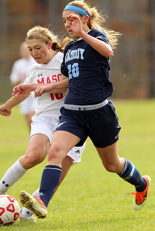 Boxford: Masco senior captain Paige Pratt (16) reaches in to poke the ball away from Peabody senior captain Madison Doherty (20) during the second half of play on Sunday afternoon. Pratt and the Chieftan defense shut down the Peabody striker and Masco took home a 1-0 win in the D1 North Quarterfinal. David Le/Salem News
