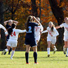 Boxford: The Masco girls soccer team run to celebrate with junior Kate Kitsakos (20) after she scored the game-winning-goal on a breakaway with under 15 minutes to play against Peabody in the D1 North quarterfinal on Sunday afternoon. David Le/Salem News