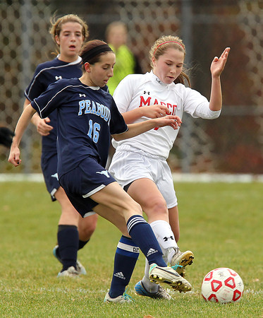 Boxford: Peabody senior captain Caroline Colbert (16) plays the ball upfield while being pressured by Masco senior Courtney Bouchard (7) on Sunday afternoon. David Le/Salem News