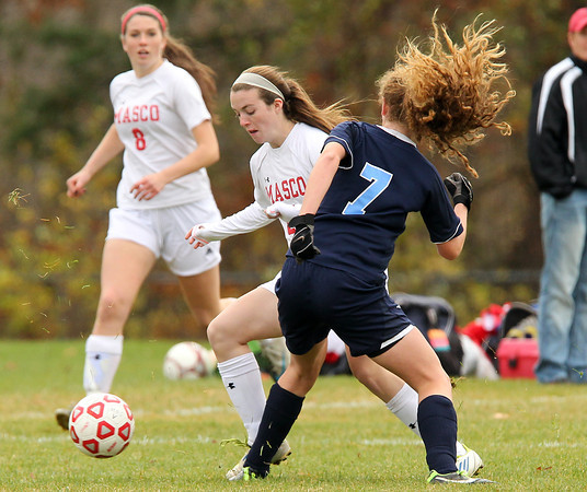 Boxford: Masco junior midfielder Kate Kitsakos (20) makes a move around Peabody freshman back Katherine Scacchi (7) on Sunday afternoon. Kitsakos scored the game's lone goal on a breakaway with under 15 minutes to play in the D1 North Quarterfinal. David Le/Salem News