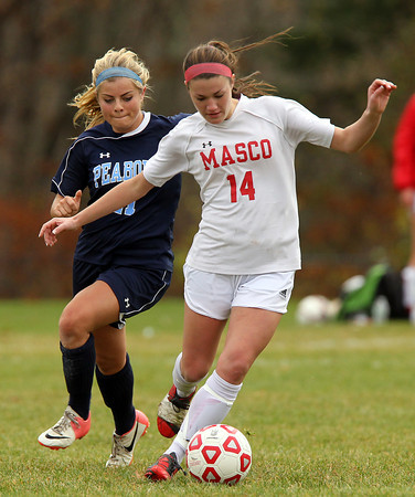 Boxford: Masco senior forward Sammi Sheehean (14) controls the ball while being pressured by Peabody midfielder Sarah Napolitano (11). David Le/Salem News
