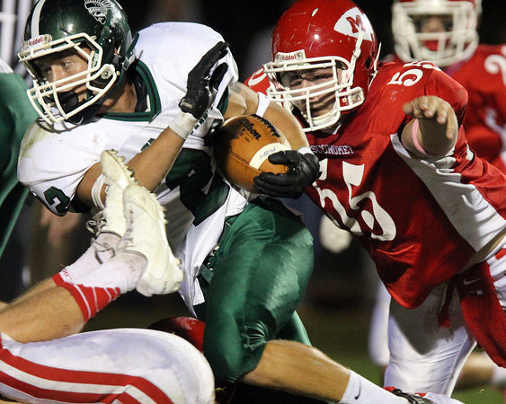 Boxford: Masco junior Steve O'Reilly (55) keeps his eyes on Pentucket running back Jeff Porter (22) and closes in to make a tackle on Friday evening. David Le/Salem News