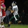 Boxford: Pentucket senior quarterback Ryan Kuchar rolls to his right and looks to pass against Masconomet on Friday evening. David Le/Newburyport Daily News