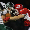 Boxford: Masco sophomore linebacker Aubrey Leake (61) stuffs Pentucket junior Andrew Noyes (41) for a loss on Fridaye evening. David Le/Salem News