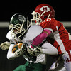 Boxford: Pentucket senior split end Liam Corkery (16) holds onto the ball while being brought down by Masco senior defensive back Harry Cwik (28) on Friday evening. David Le/Newburyport Daily News
