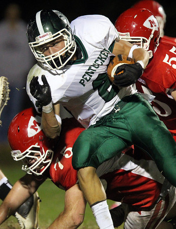 Boxford: Pentucket junior running back Jeff Porter (22) keeps his eyes upfield as he plows through the Masco defense on Friday evening. David Le/Newburyport Daily News
