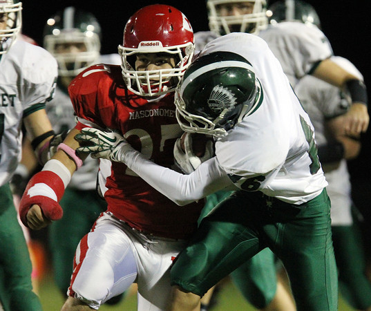 Boxford: Newburyport senior Liam Corkery (16) tries to bring down Masco senior running back Mike Tivinis (27) on Friday evening. David Le/Newburyport Daily News