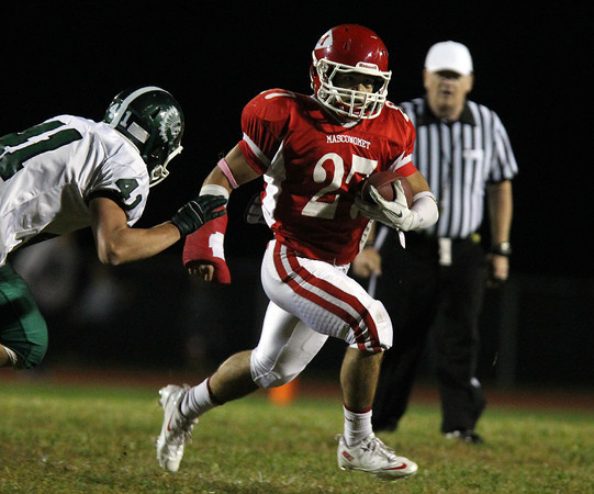 Boxford: Masco senior running back Mike Tivinis (27) breaks to the outside and manages to elude Pentucket junior Andrew Noyes (41) on Friday evening. David Le/Salem News