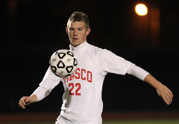 Lynn: Masco senior striker Stephen Pease (22) brings the ball down using his chest during the second half of play of the D2 State Final against Walpole on Thursday evening at Manning Field in Lynn. David Le/Salem News