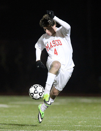 Lynn: Masco senior midfielder PJ Criscione (4) carries the ball upfield against Walpole during the first half of the D2 State Championship on Thursday evening at Manning Field in Lynn. David Le/Salem News