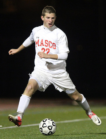 Lynn: Masco senior striker Stephen Pease (22) carries the ball upfield against Walpole on Thursday evening. David Le/Salem News