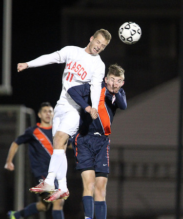 Lynn: Masco senior captain Adam Grammar (11) wins a header over a Walpole player during the first half of the D2 State Championship on Thursday evening at Manning Field in Lynn. David Le/Salem News