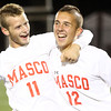 Lynn: Masco seniors Adam Grammar (11) and Jack Heintzelman (12) celebrate the Chieftans' win in the D2 State Championship on Thursday evening at Manning Field in Lynn. David Le/Salem News