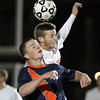 Lynn: Masco senior captain Adam Grammar (11) wins a header over Walpole senior Robert Ivatts (10) during the first half of the D2 State Championship on Thursday evening at Manning Field in Lynn. David Le/Salem News